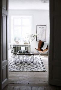 Black and white interior with the butterfly as an accent - via DustJacket